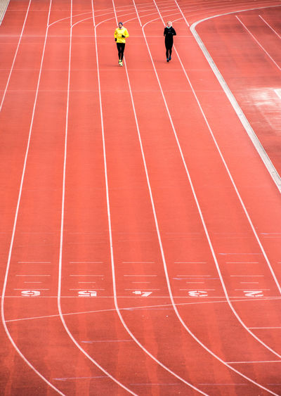 High Angle View Of Athlete Practicing On Running Track