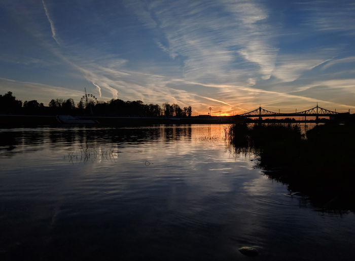 Colorful sunset on the Volga River in the Russian city of Tver Russia Volga River Beauty In Nature Bridge Cloud - Sky Connection Nature No People Outdoors Plant Reflection Scenics - Nature Silhouette Sky Sunset Tranquil Scene Tranquility Travel Destination Water Waterfront