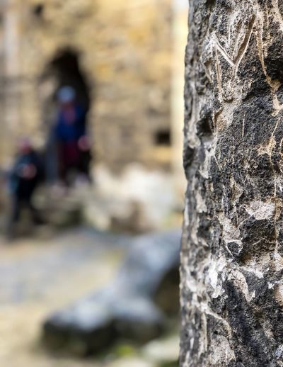 People love to leave their mark Marks Carvings In Stone History Historical Building Stonework Castle Focus On Foreground Tree Trunk Trunk Day Close-up Textured  Tree Rough Outdoors People Selective Focus