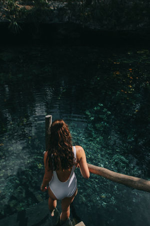 Girl walking on steps at Cenote Nicte Ha, Mexico Bathingsuit Beauty In Nature Cave Cenote Cenotes Fashion Girl High Angle View Lifestyles Mexico Nature Nature People Standing Steps Travel Travel Blogger Travel Photography Turquoise Water Water Women Young Women