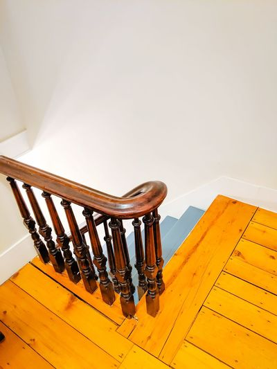 High angle view of spiral staircase on table against wall at home