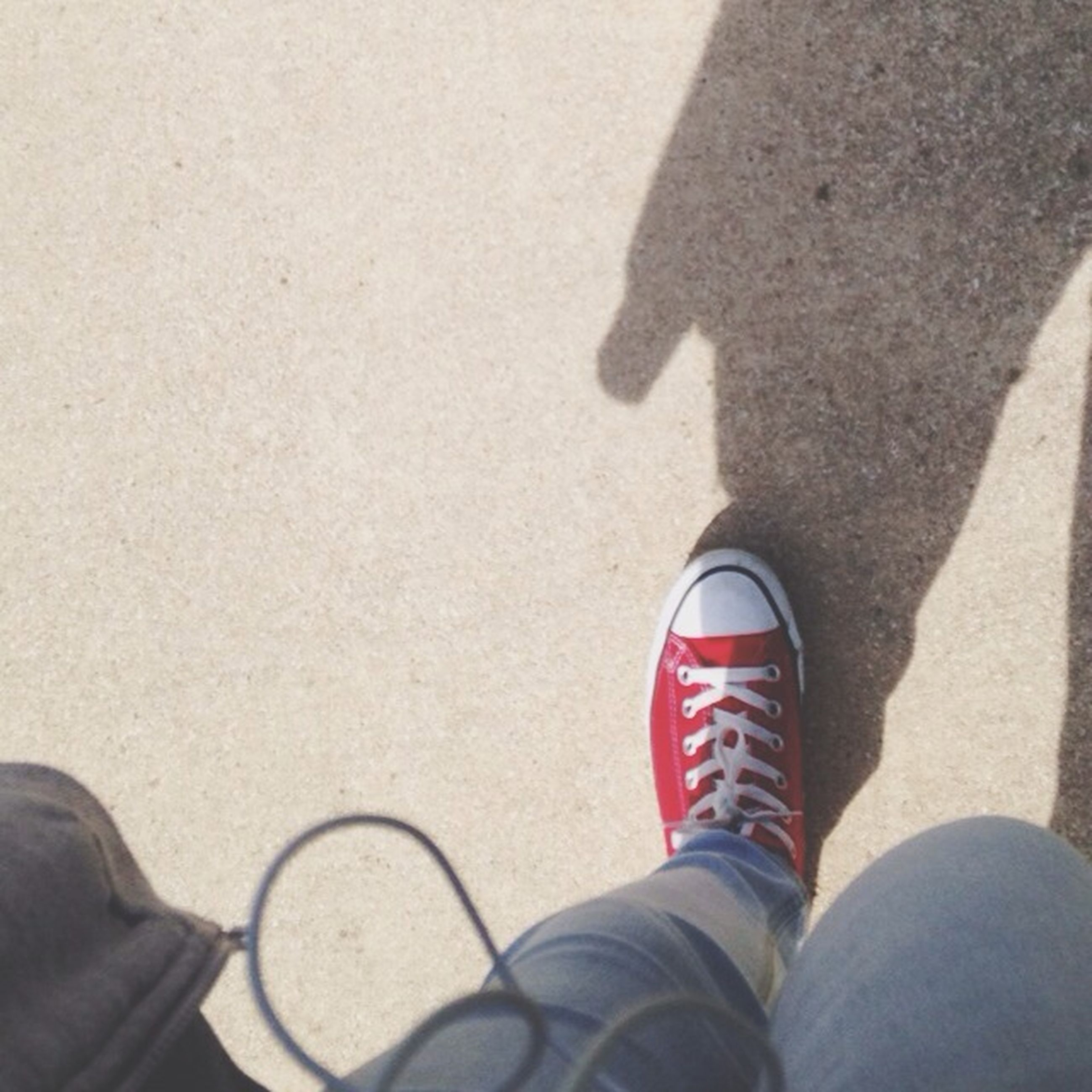 low section, person, personal perspective, lifestyles, shoe, men, leisure activity, part of, street, human foot, standing, high angle view, unrecognizable person, road, sunlight, shadow, day