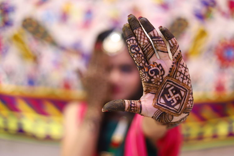 Close-up of bride showing henna tattoo