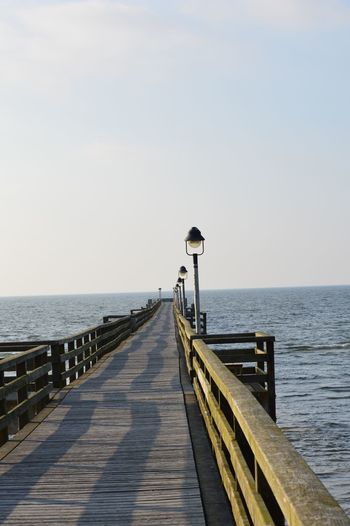 Strand und Meer Sea Water Sky Horizon Over Water Horizon Scenics - Nature Pier Beauty In Nature Tranquil Scene Clear Sky Wood - Material Tranquility Railing Nature Direction The Way Forward Day Copy Space Street Light No People