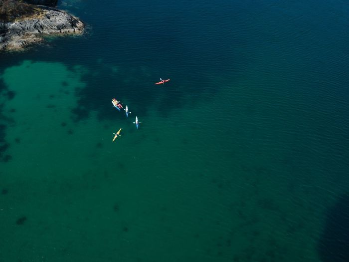 High angle view of kayaks in sea