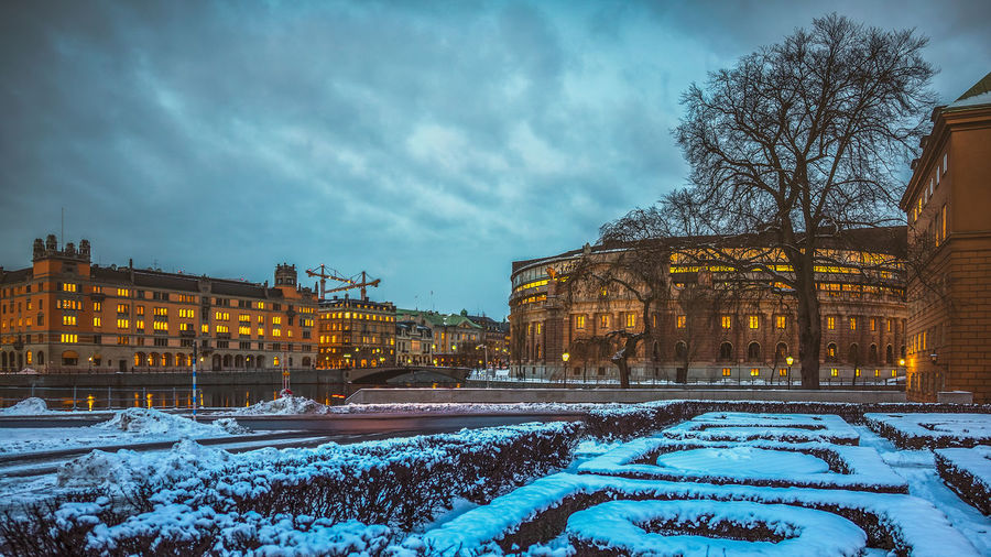 Winter in Stockholm Lowlight Architecture Bare Tree Building Building Exterior Built Structure City Cloud - Sky Cold Temperature Covering Day Dusk In The City Frozen Illuminated Leafless Nature No People Outdoors Overcast Plant Sky Snow Sombre Tree Winter