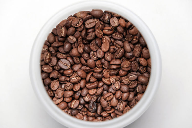 Directly above shot of coffee beans in bowl
