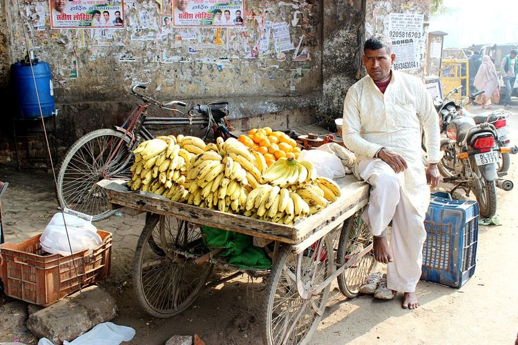 A fruit seller in New Delhi, India in December 2016 Humans Of India Job Delhi New India Streets Work Food And Drink One Person Food Occupation Small Business Real People Freshness Store Business For Sale Adult Men Retail  Working Street Market Selling