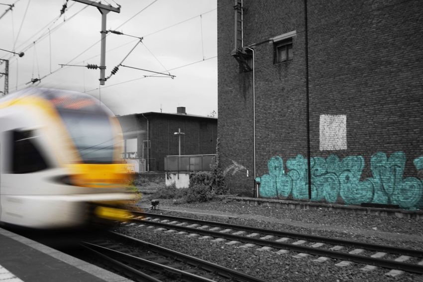 Transportation Rail Transportation Track Railroad Track Mode Of Transportation Public Transportation Architecture Motion Built Structure No People Train Building Exterior Blurred Motion Train - Vehicle City Day Outdoors on the move Travel