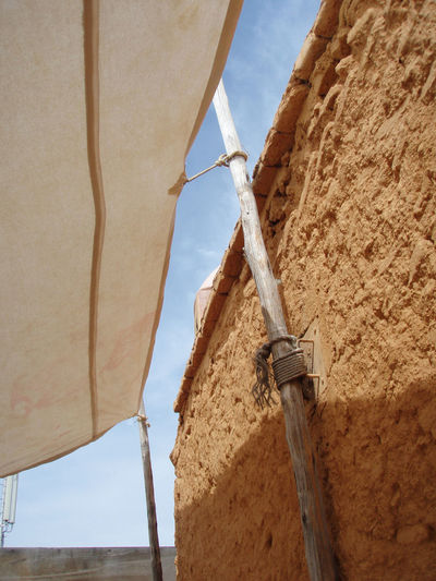 Adventure Africa Arid Climate Blue Sky Desert Dry Fabric Marrakech Medina Morocco Natural Colors Old Roof Rooftop Shadow Sky Stone Wall Sun Texture Textured  Travel Wall Wood