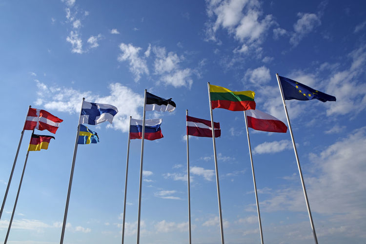 Low Angle View Of Flags Against Sky