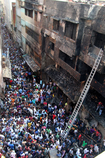 High angle view of crowd amidst buildings in city