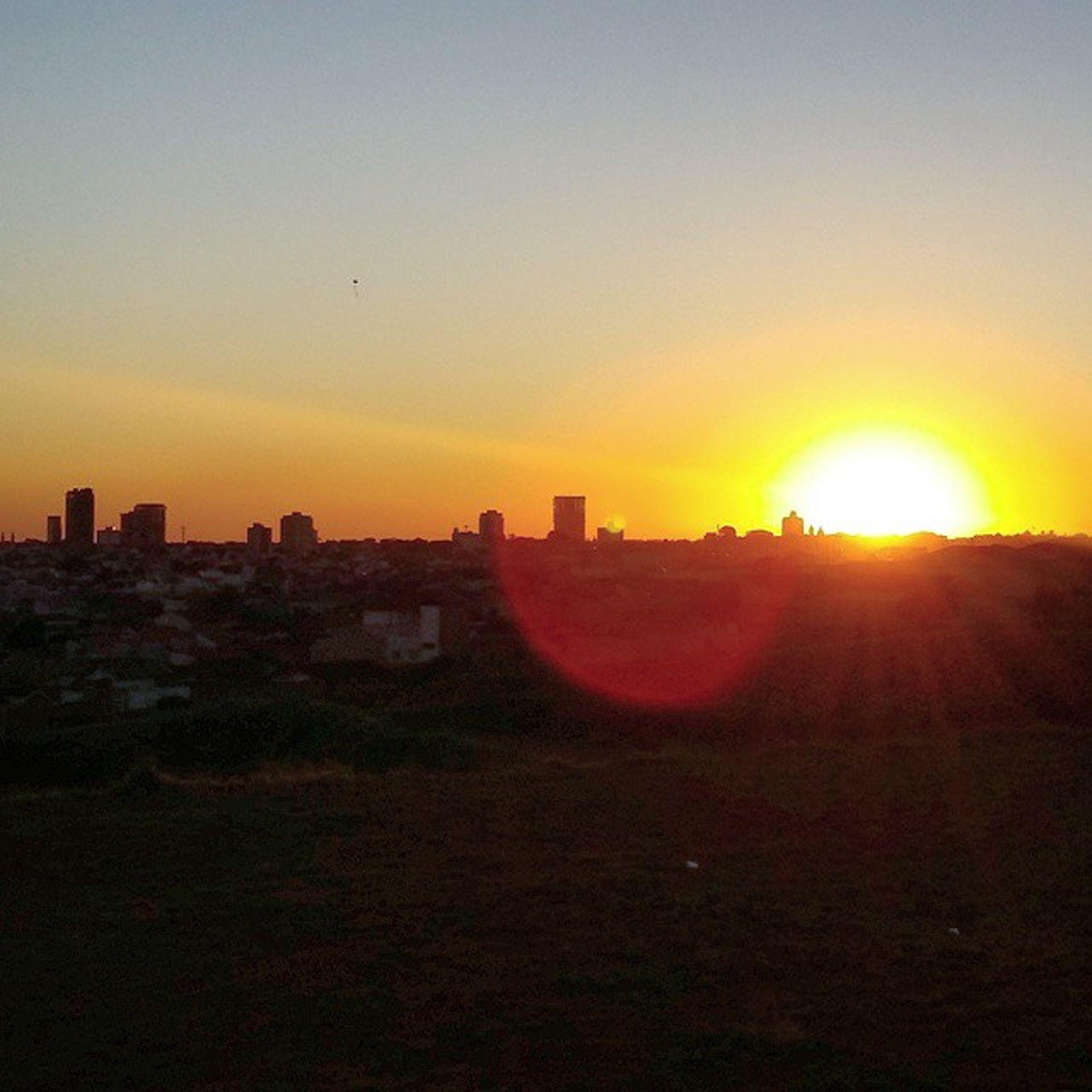 sunset, sun, orange color, built structure, building exterior, architecture, sunlight, lens flare, sunbeam, silhouette, sky, copy space, landscape, city, scenics, clear sky, nature, beauty in nature, tranquil scene, outdoors