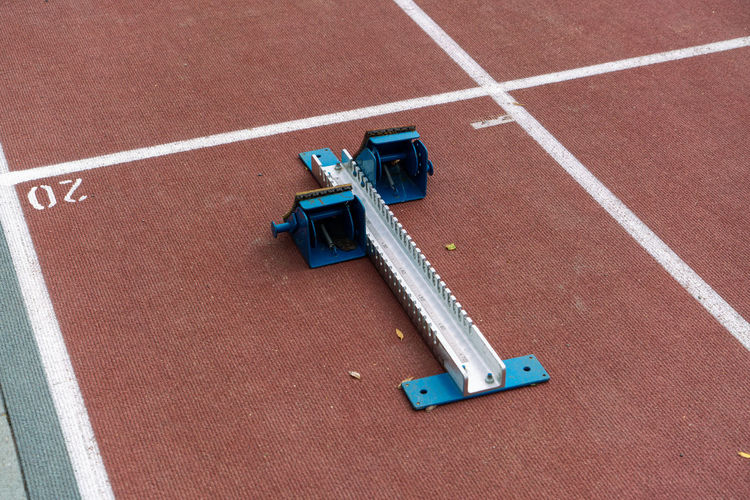 High angle view of track starting block on running track