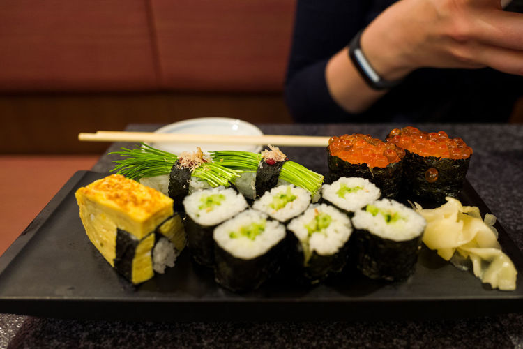 High angle view of sushi served in tray on table