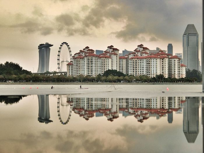 Reflection Of City On Sea