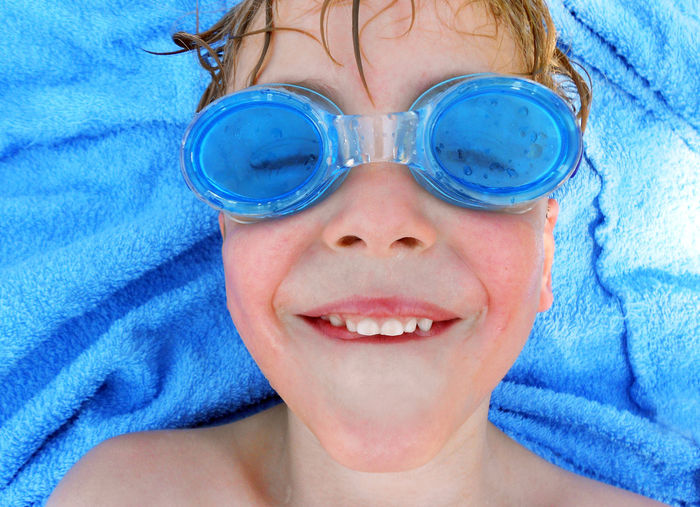 Goggles Blue Boys Child Childhood Close-up Day Elementary Age Front View Grimace Grimasse Happiness Headshot Human Face Indoors  Leisure Activity Lifestyles Looking At Camera One Person People Portrait Real People Schwimmbrille Smiling Towel
