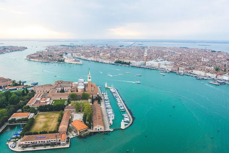 Water Architecture Sea Nautical Vessel High Angle View Built Structure Aerial View Building Exterior City Transportation Sky Mode Of Transport Cityscape Day Travel Destinations Cloud - Sky Outdoors Ship No People Waterfront EyeEm Gallery Lost In The Landscape Venice, Italy Droneshot Venezia The Great Outdoors - 2018 EyeEm Awards