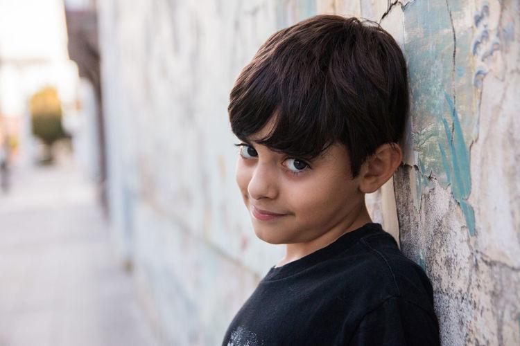 Portrait of teenage boy looking at wall