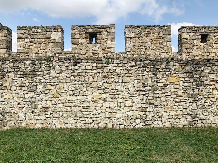 Brick wall against sky