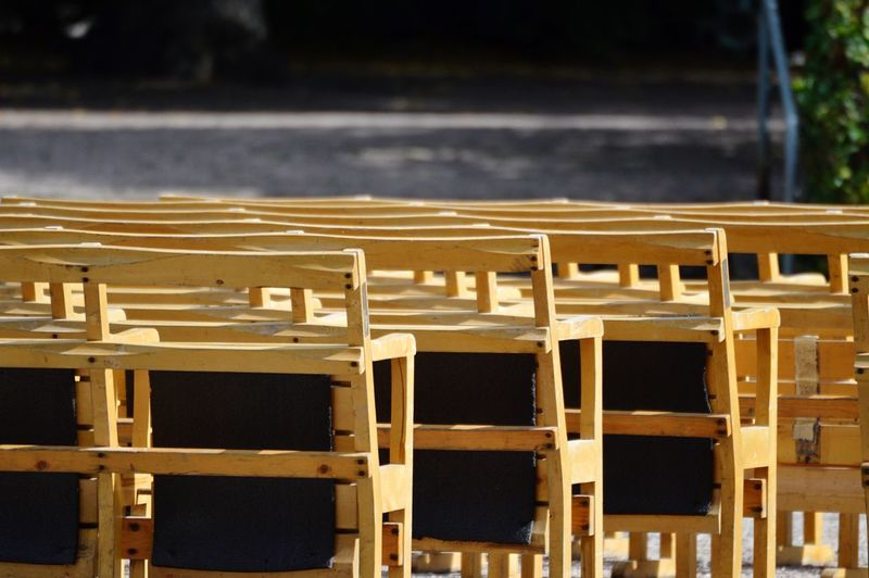 Close-up of chairs in row
