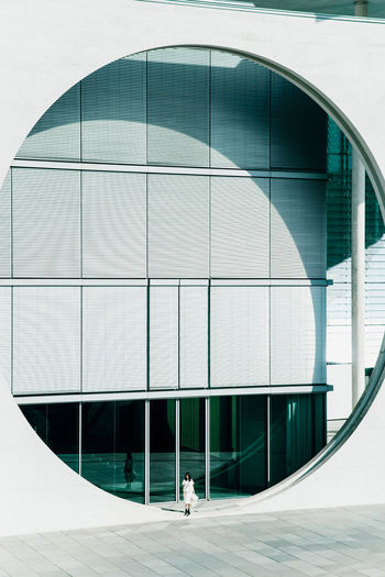 Architecture Built Structure Building Exterior Building City Modern Day Glass - Material Real People Geometric Shape Office Building Exterior Sunlight People Reflection Outdoors Shape Walking Window Full Length