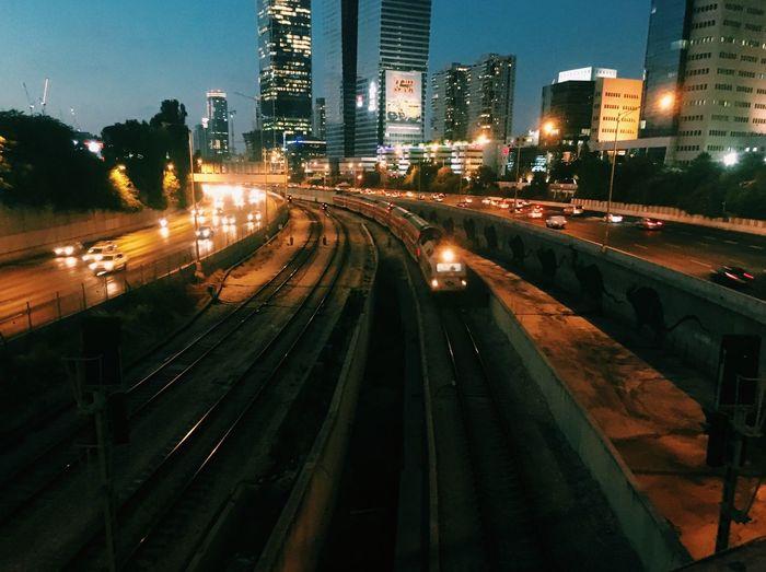 High angle view of illuminated railroad tracks at night