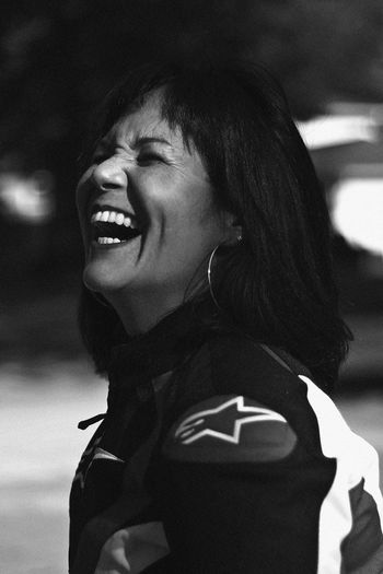 Laugh, 2018 Smiling Happiness One Person Headshot Portrait Emotion Leisure Activity Real People Lifestyles Focus On Foreground Women Toothy Smile Teeth Looking Cheerful Looking Away Young Adult Females Side View Hairstyle Laughing Laugh Happiness Black And White Dimples  International Women's Day 2019