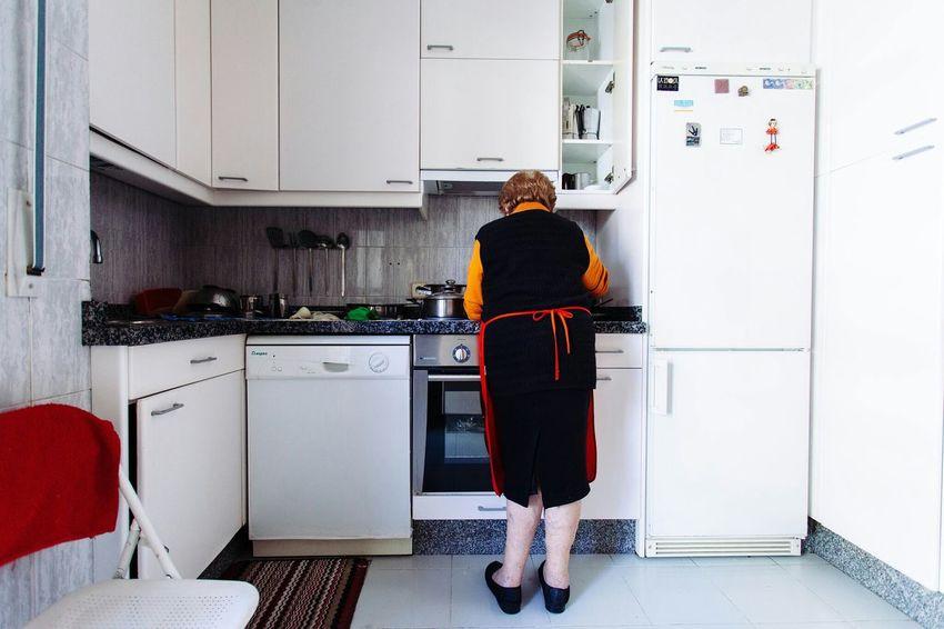 The Portraitist - 2015 EyeEm Awards Woman Portrait Of A Woman Kitchen White Cooking The Photojournalist - 2015 EyeEm Awards