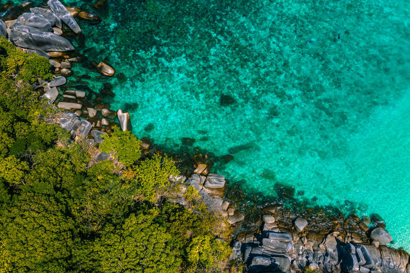 Aerial View of Boulder Island, Myanmar Sea Water Nature Landscape Tree Holiday Blue Travel Day Outdoors Forest Rock Paddle Plant Land Beauty In Nature Indian Ocean Andaman Green Color High Angle View Turquoise Colored Scenics - Nature Boulder Island Nga Khin Nyo Island Aerial View