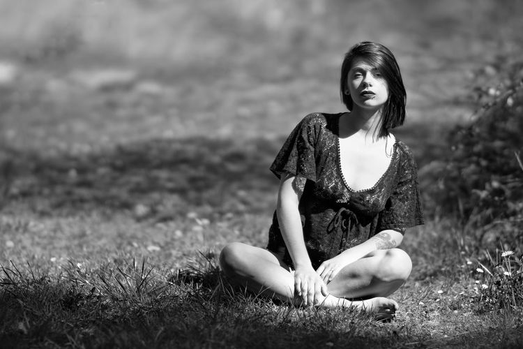 Sitting in trankility Grass Nature Fashion Beauty Field One Person People Portrait Beautiful People Outdoors Sitting Beauty In Nature Portrait De France Alpha 77 II Taking Photo Getting Creative Monochrome Black And White Black & White Taking Pictures Taking Photos Fashion Model Lifestyles Fashion Looking At Camera