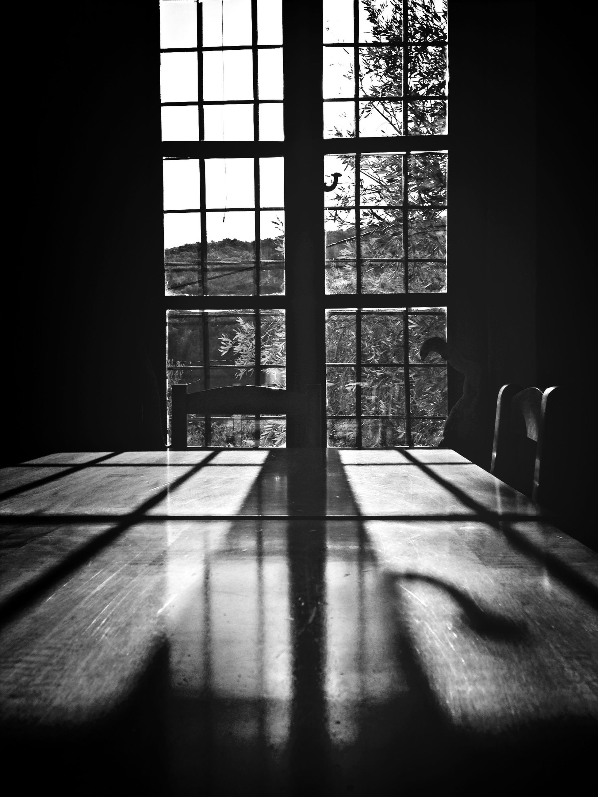 indoors, window, architecture, glass - material, home interior, built structure, transparent, table, shadow, sunlight, curtain, flooring, house, tiled floor, day, absence, chair, empty, window sill, building exterior