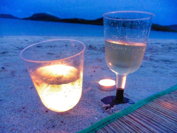 Midnight Moment on Beach in Vatersay Wine moments Moment moments of happiness Beach Barra Vatersay Travel Photography Scotland VisitScotland Drink Refreshment Glass Alcohol Food And Drink Household Equipment Drinking Glass Fire Burning Freshness Candle Flame No People Nature Illuminated Close-up Fire - Natural Phenomenon Wine Tea Light Springtime Decadence