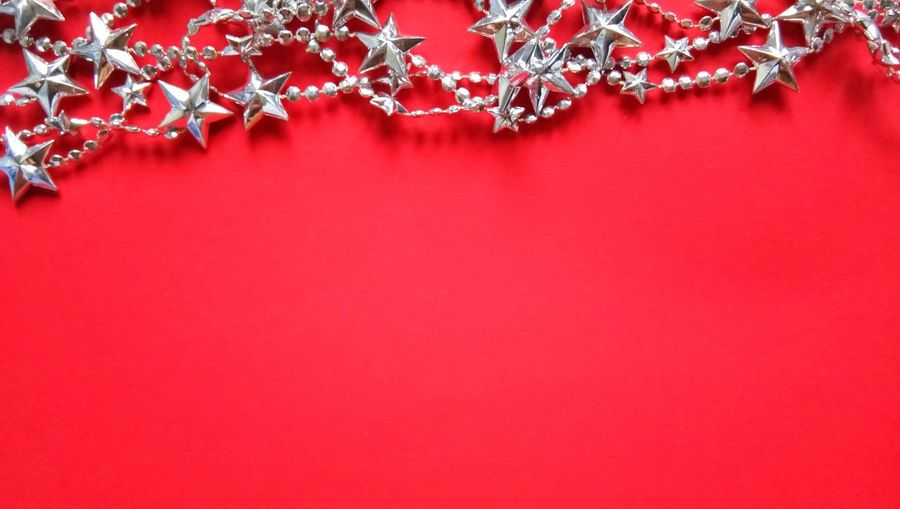 High Angle View Of Christmas Decorations Over Red Background