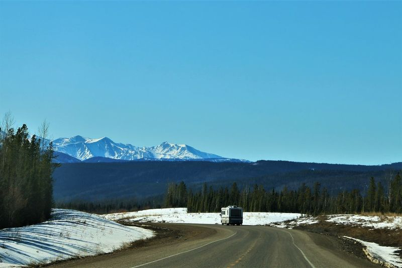 RV traveling down winding road in Canada Mountain Mountain Range Cold Temperature Winter Clear Sky Snow Copy Space Day Snowcapped Mountain Outdoors Travel Camper Recreational_vehicle Rv Road Road Trip