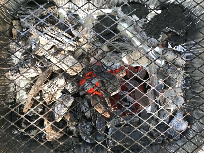 BBQ Coal Fire Coal Metal Day No People High Angle View Outdoors Security Fence Grid Protection Chainlink Fence Metal Grate Backgrounds Large Group Of Objects Full Frame Barrier Boundary Pattern Safety