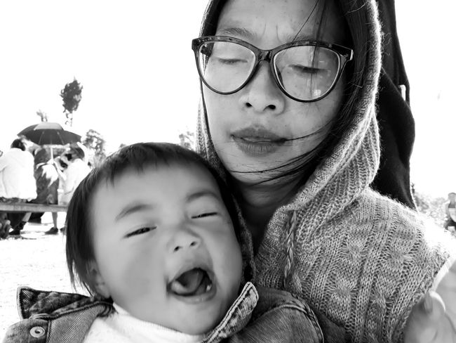 #blackandwhite photography This Is Family EyeEmNewHere Aunt And Niece Blackandwhite Outdoors Photography Expression Child Childhood Bonding Togetherness Happiness Headshot Portrait Human Face Love Family Bonds Hood - Clothing
