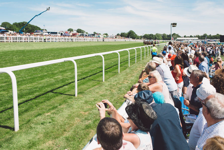 Adult Arts Culture And Entertainment Boys Building Exterior Childhood Crowd Day Epsom Downs Racecourse Large Group Of People Leisure Activity Lifestyles Men Outdoors People Photographing Playing Real People Sky Togetherness Women