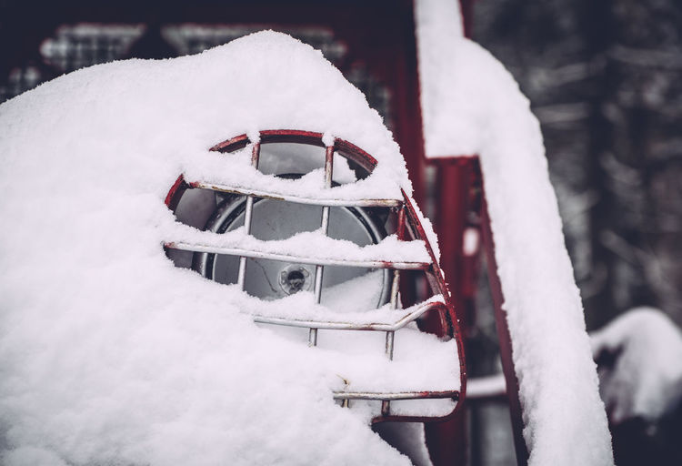 Close-up of snow covering headlight