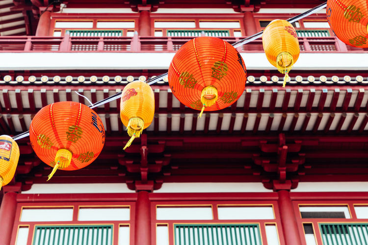 Low angle view of lanterns hanging outside building, chinatown singapore