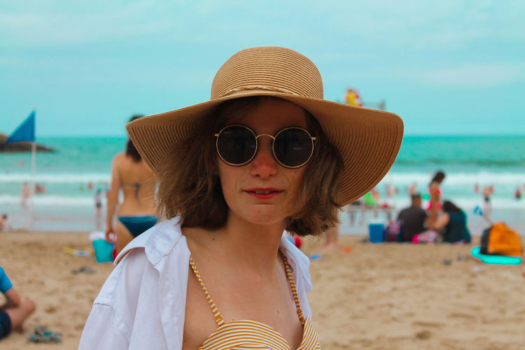 Portrait of man wearing hat on beach