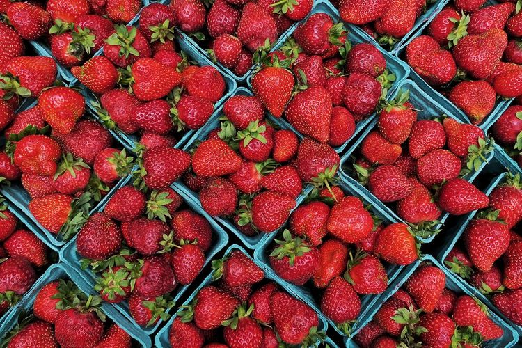 High Angle View Of Strawberries In Container For Sale At Market Stall