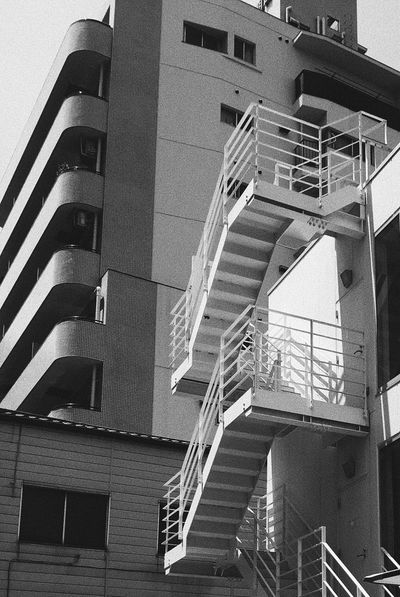 Unplan Kagurazaka Architecture Built Structure Staircase Building Exterior Steps Steps And Staircases Low Angle View Railing Window Fire Escape No People Day Outdoors Spiral Staircase City Kagurazaka The Architect - 2018 EyeEm Awards