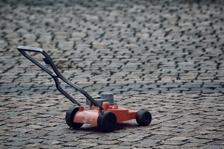 Lawn mower on footpath