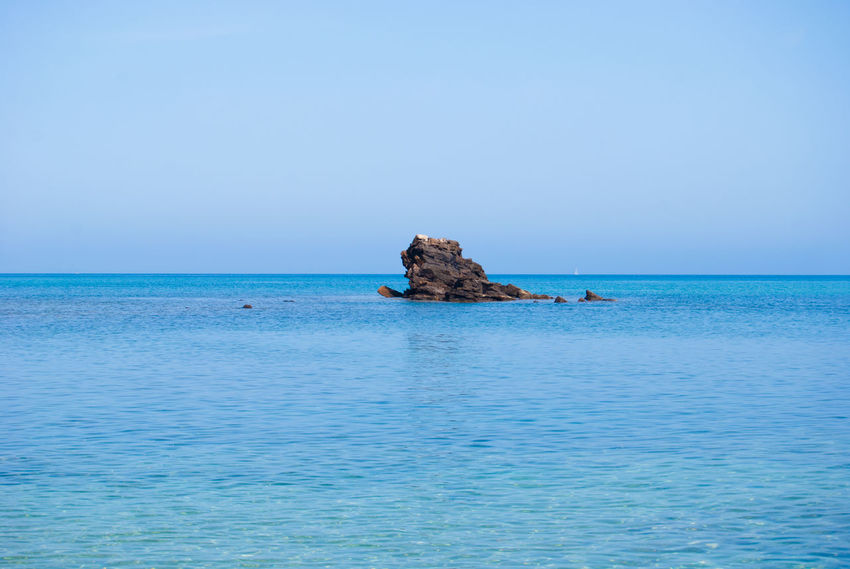 Rock Beauty In Nature Blue Clear Sky Day Horizon Horizon Line Horizon Over Water Idyllic Mode Of Transportation Nature Nautical Vessel No People Outdoors Scenics - Nature Sea Sky Tranquil Scene Tranquility Transportation Water Waterfront