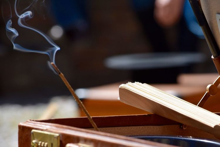 Close-Up Of Incense Stick Against Blurred Background