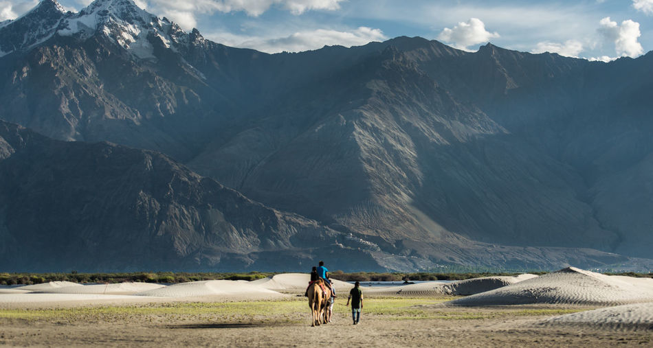 Nubra Valley, Ladakh, India Adult Adventure Beauty In Nature Day Full Length Hiking Landscape Lifestyles Mammal Men Mountain Mountain Range Nature One Person Outdoors People Physical Geography Real People Rear View Scenics Sky Snow Walking