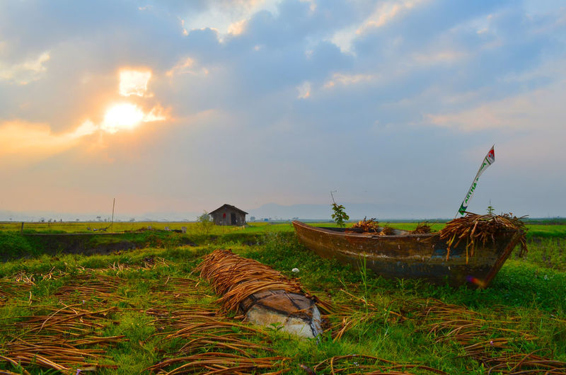 Rawapening INDONESIA Sky Grass Cloud - Sky Plant Nature Land Field No People Tranquility Scenics - Nature Abandoned Sunset Environment Tranquil Scene Nautical Vessel Day Outdoors Growth Beauty In Nature Landscape Deterioration Boat