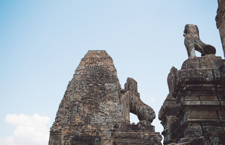 Siem Reap Cambodia Angkor Representation Sculpture Art And Craft Architecture Statue History Religion Low Angle View Belief The Past Spirituality Place Of Worship Travel Destinations Human Representation Built Structure Ancient Sky Creativity Male Likeness No People Ancient Civilization Outdoors Ruined