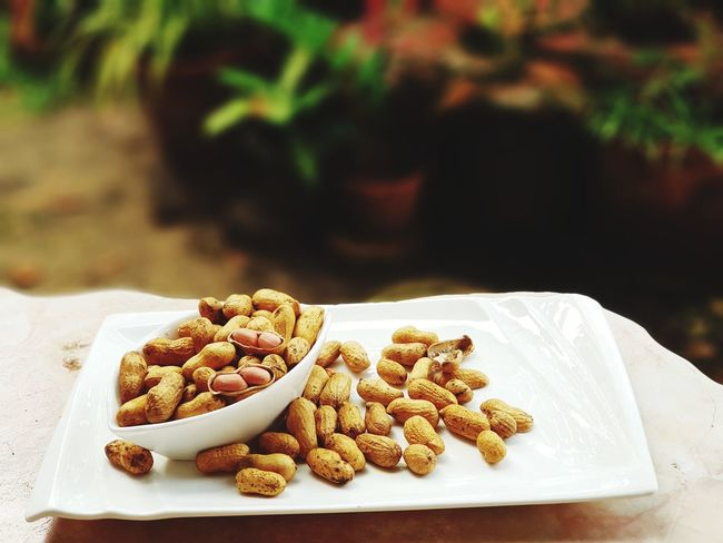 the roasted peanut on white dish . monkey nut Nut - Food Healthy Eating Raisin Peanut - Food No People Food And Drink Dried Fruit Close-up Healthyliving Food And Drink Food No People Freshness Healthy Eating Close-up Ready-to-eat EyeEmNewHere Healthychoices Thailand🇹🇭 Healthy Lifestyle Healthy Diet Healthcare And Medicine Healthy Lifestyle Healthychoices Healthy Diet Groundnuts Groundnut